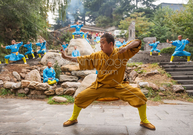 This Rights-Managed stock photo of Shaolin martial arts school instructor and students practicing Qi Gong outside by Alex Maxim, is available for commercial, editorial or personal usage. You can buy a license of this image at MaximImages.com.