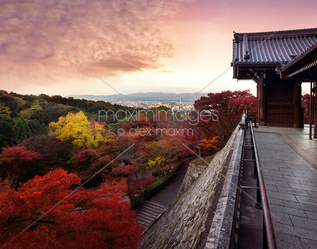 Todoroki-mon gate of Kiyomizu-dera temple in colorful autumn sunrise Kyoto city scenery