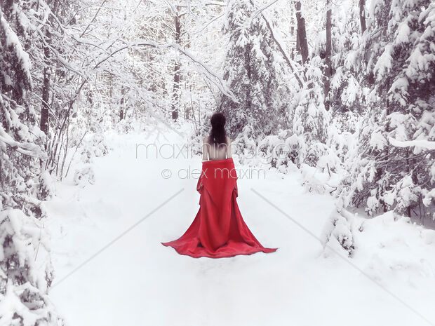 Woman in red kimono and bare shoulders walking away in snow