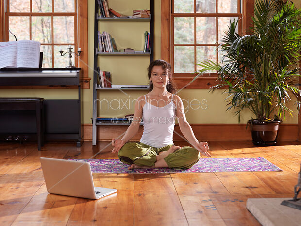 Stock Photo Of Woman Sitting In Yoga Meditation Pose At Home