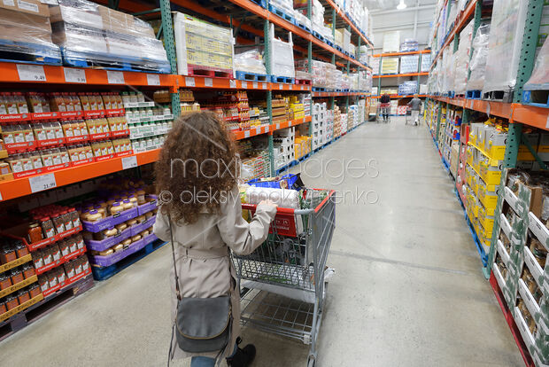 photo of woman with a shopping cart at costco wholesale warehouse store stock image mxi30523. Black Bedroom Furniture Sets. Home Design Ideas
