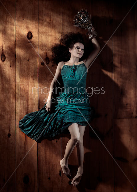 Photo of Young woman in green dress