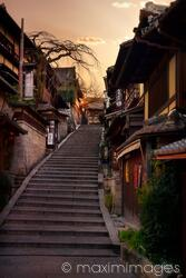 Stairs at Yasaka dori historic street in Kyoto empty and quiet in early morning colorful autumn sunrise